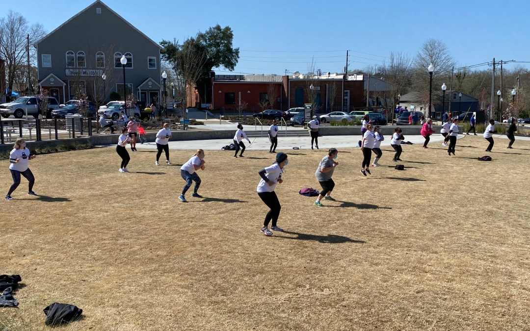 Several women taking part in HER Fitness boot camp on March 20, 2021