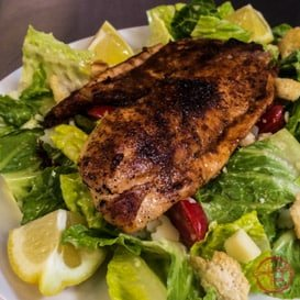 Homemade Caesar salad recipe with blackened tilapia.