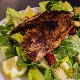Homemade Caesar salad recipe with blackened tilapia.