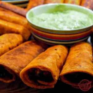 Crispy chicken flautas - the perfect party food.