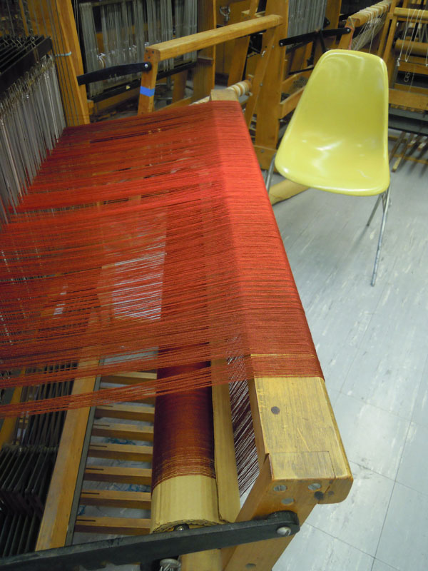 This is warp as it rises up over the back beam of the loom.The threads remain parallel.
