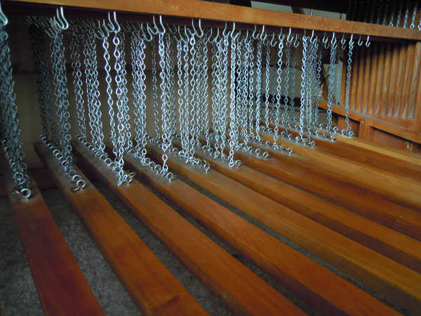 The treadles (on my Kyra loom) attached to the lams via chains.