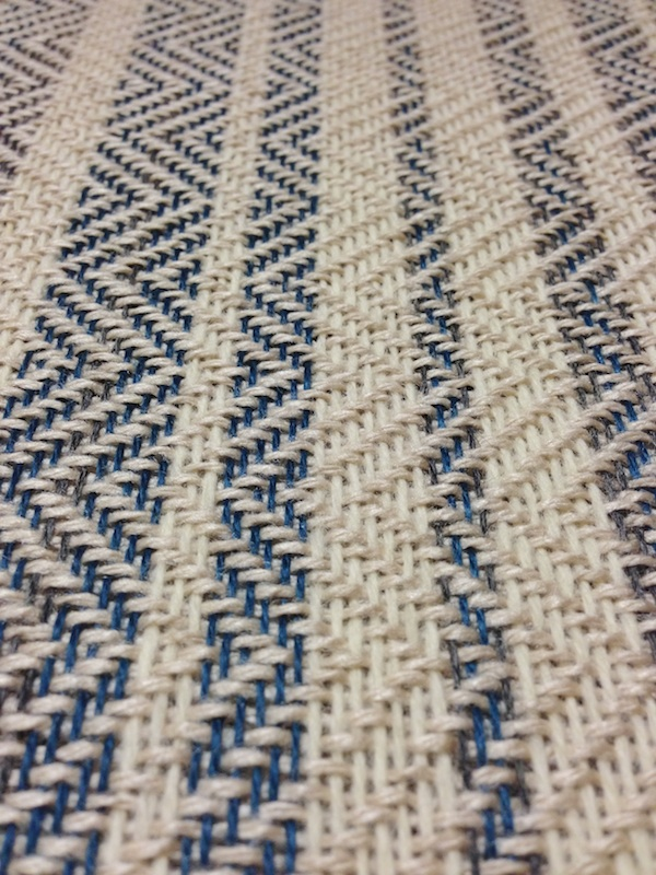 A detail of the weaving on the loom.