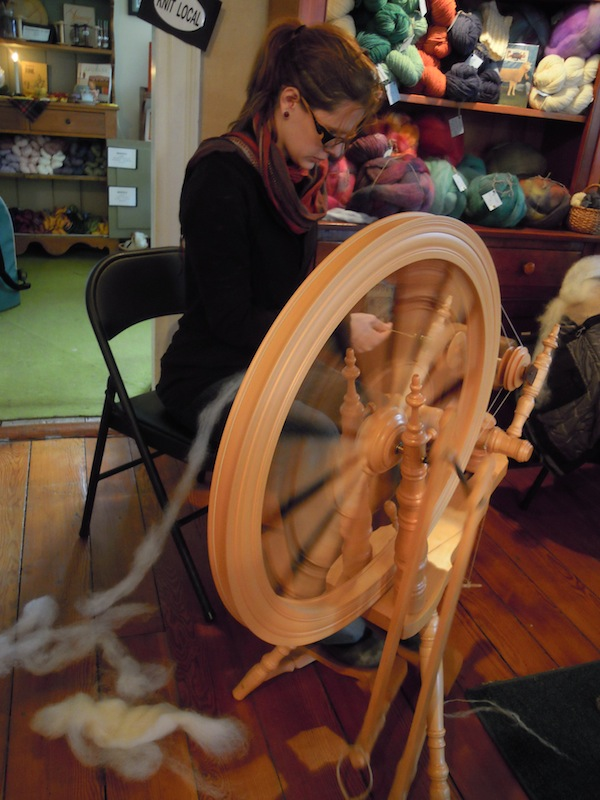 Taking a short class on how to spin on a wheel that is much fancier then what I actually have.