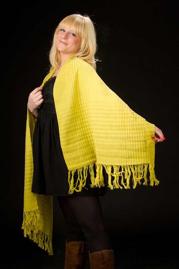 A very yellow shawl that I wove, toned down with two shades of green. Woven in a swedish lace pattern.