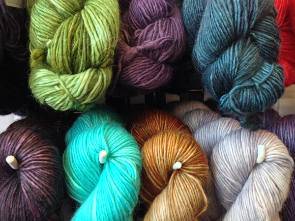 Beautiful single ply yarns hung in skeins.
