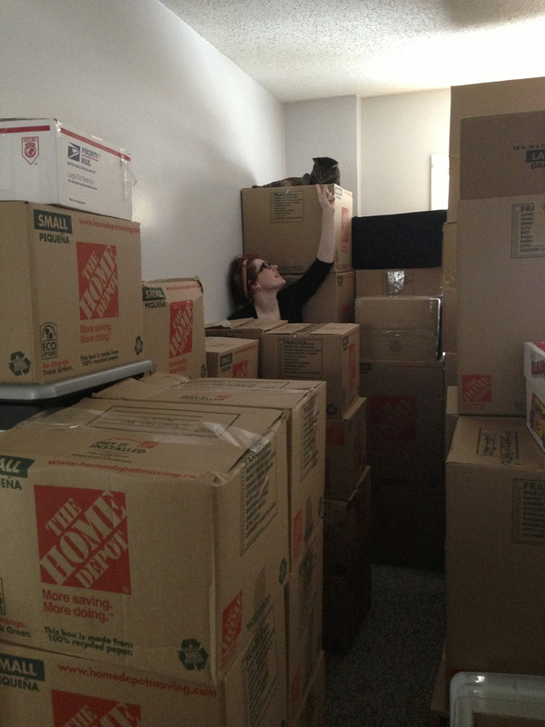 Rupert and I amongst the mountain of boxes in our last apartment.