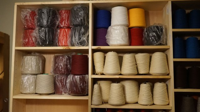 Some of the designated yarns. The all white wool yarn are reserved for blankets, and the cottons were ordered for a run of bandanas.