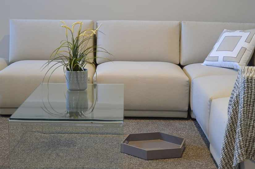 SOFA NEXT TO GLASS TABLE