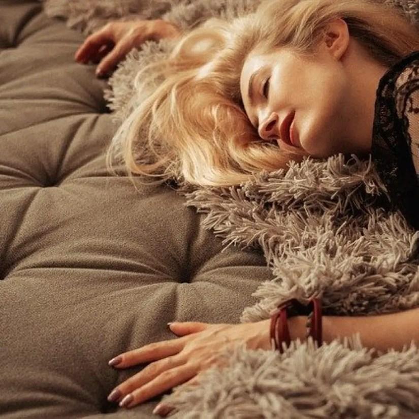 blonde lady laying on sofa