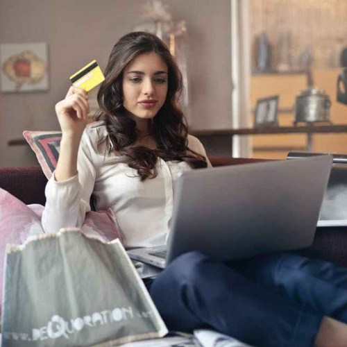 Woman shopping online using credit card