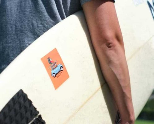 square sticker on a surfboard