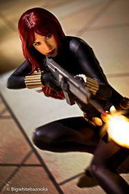 Black Widow cosplayer firing a machine gun