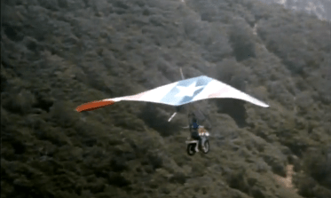 Captain America and his motorcycle go hanggliding