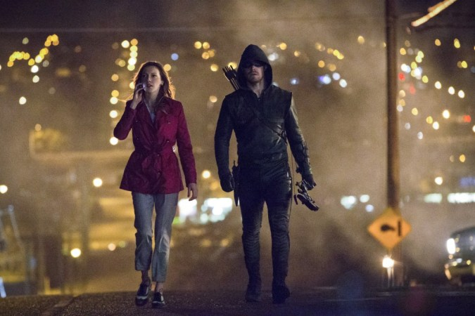 Katie Cassidy as Laurel Lance and Stephen Amell as The Arrow
