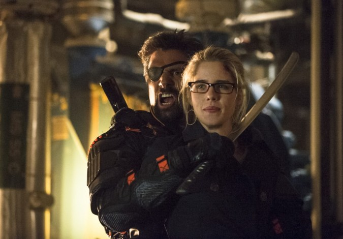 Manu Bennett as Slade Wilson and Emily Bett Rickards as Felicity Smoak in Arrow
