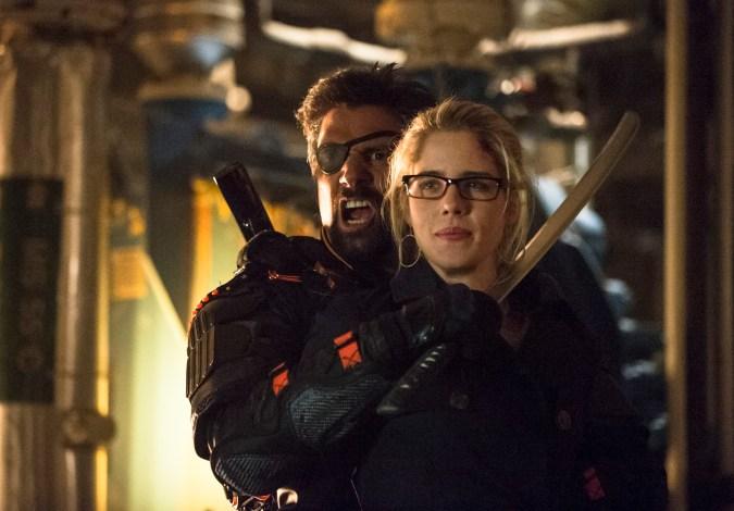 Manu Bennett as Slade Wilson and Emily Bett Rickards as Felicity Smoak in Arrow