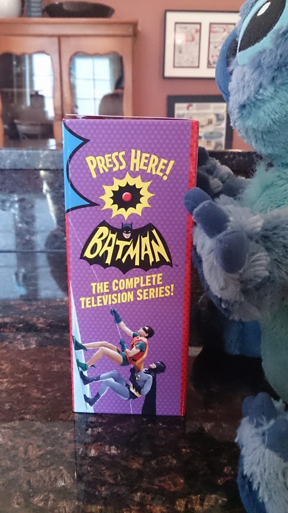 The side of the Batman: The Complete Series box has a button that plays the Batman theme song