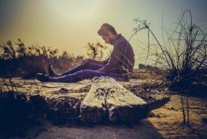 man-sitting-near-brown-wood-plank-734479