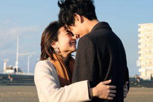 Closeup of young couple embracing at beach