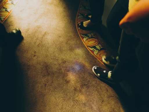 sun spots on the carpet, reflections of the stained glass window