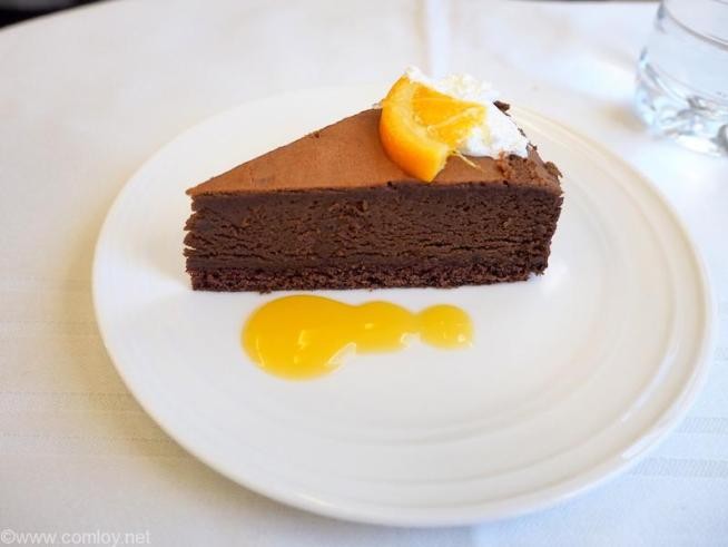DESSERT Baked chocolate cake with orange sauce