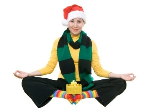 Funny asian girl in santa's hat meditating, isolated on white