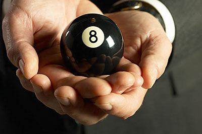 man holding 8 ball