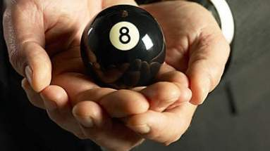 man holding 8 ball