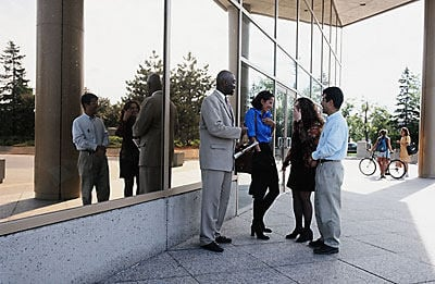 people standing in group outside of building