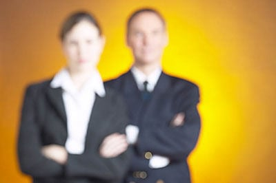 two blurred business people standing