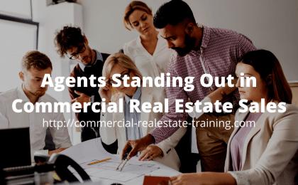 sales team standing around desk