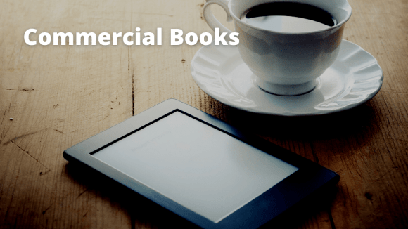 coffee cup and books on Kindle