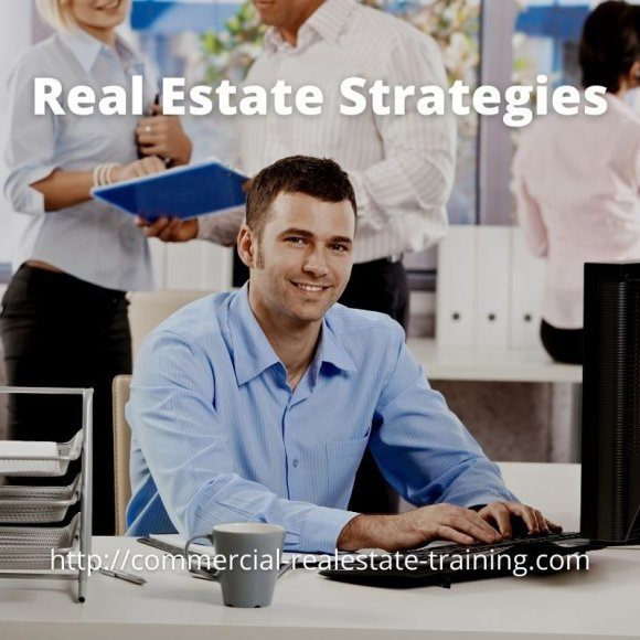 real estate agent sitting at desk and smiling