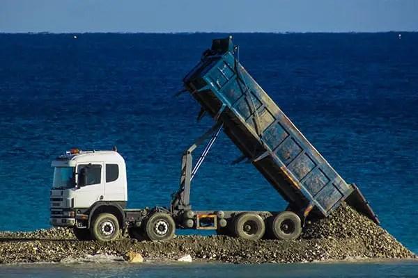 Dump truck dumping a load