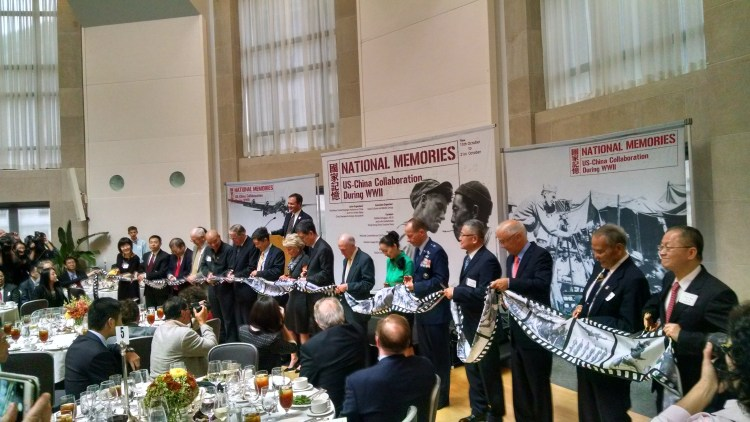 Distinguished guests and organization representatives cut ribbon to mark opening of National Memories exhibition