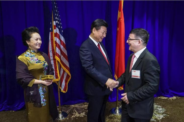 President Xi Jinping with Committee of 100 member Cheng Li
