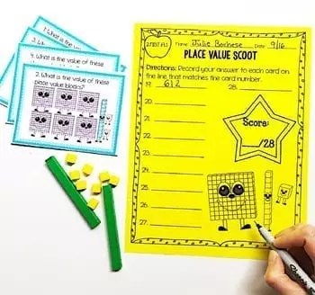 Place Value Scoot game page with game question cards and counter manipulatives