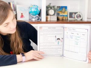 Woman holding literature journal with one page showing a story focused on character traits and another showing a student worksheet.
