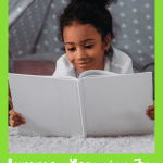 Girl reading a book with a white cover during summer time in order to prevent the summer slide