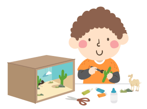 Child with brown hair and orange shirt with a box and cutouts creating a Diorama of a desert scene as part of a fun book project
