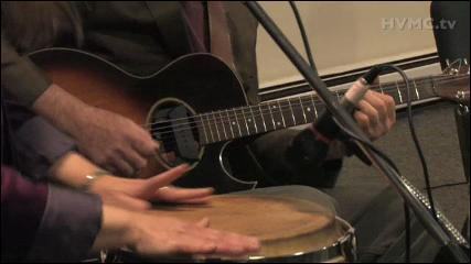 """These hands belong to Karen Savoca and Pete Heitzman. Click on the photo to watch them play along with Maura Kennedy on Maura's song """"Is It Just The Rain"""" (Video courtesy of Simon Feldman, Hudson Valley Music Channel)"""