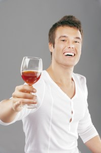 handsome man lifts toast about wine glass