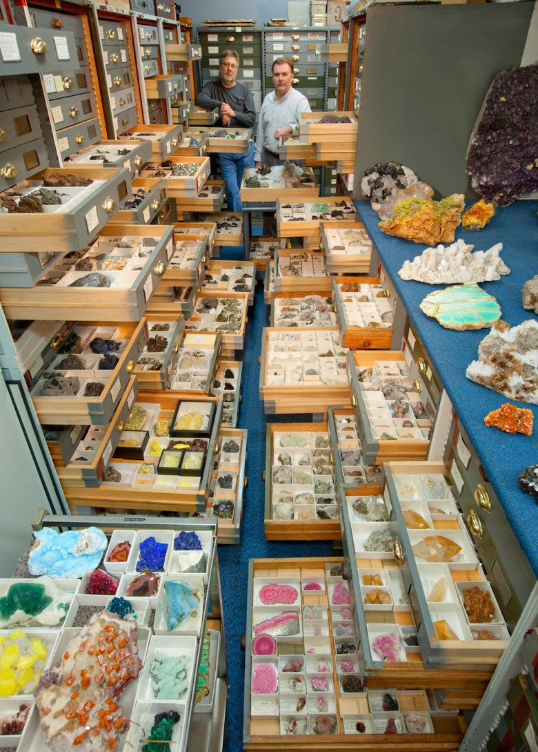 """An assortment of mineral specimens  displayed in the storage vault known as the """"Blue Room,"""" at the Smithsonian Institution's National Museum of Natural History"""