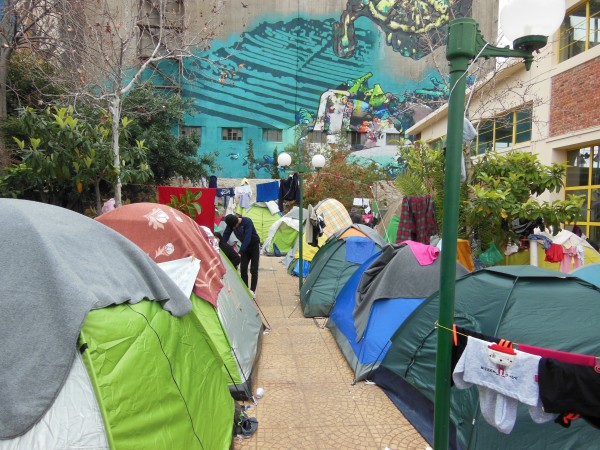 Tent city (and hipster murals) at Athen's Port of Piraeus, an informal refugee encampment maintained by volunteers. March 2016