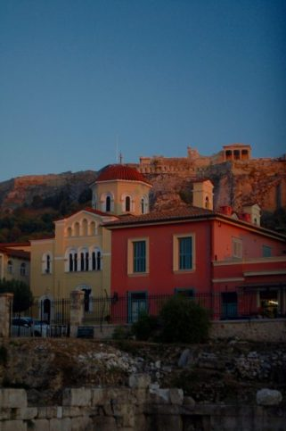 The sun sets over the Acropolis.