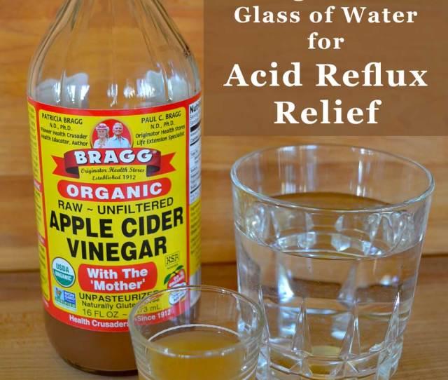 Apple Cider Vinegar Shot Glass Alongside Vinegar Bottle And Glass Of Water