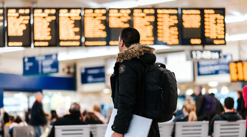 A picture of a man standing in a train station