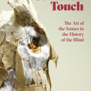 Picture shows the catalog cover illustrated with a profile, close-up of Teresa Jaynes's Gift #1, a brown and white paper owl. Text in red letters is printed to the upper right of the image of the owl. Text reads: Common Touch [next line] The Arts of the Senses in the History of the Blind. [end of description]