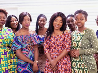30 Days Of Women In Business - Group of Female African Girls in Traditional Clothing, Smiling at the Camera